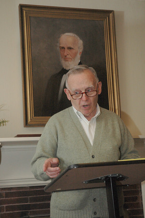 Gus Reusch, curator of John Greenleaf Whittier's birthplace in Haverhill, speaks about the 19th century poet during a lecture at the Whittier home in Amesbury last Thursday. Reuch's visit is related to the Amesbury Public Library's On the Same Page program, which seeks to highlight the city's rich abolitionist's history during a lengthy community wide event.  Dave Rogers photo