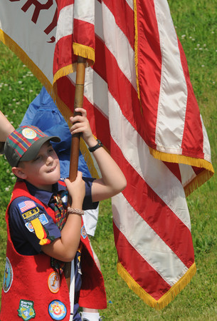amesbury: Nicholas Muryn, 8, carries the Stars and Stripes into Landry Stadium for the annual Amesbury Memorial Day ceremony. Jim Vaiknoras/staff photo
