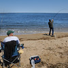 Newburyport: Two fisherman try their luck in the Merrimack River off Olum Island Point. jim Vaiknoras/staff photo