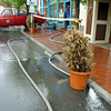Amesbury: <br /> One of Amesbury Fire Department forestry trucks pumps out the basement of the Powow River Grille in Market Sqaure.  The Powow River flows immediately behind the restaurant, crossing underneath the roadway.<br /> Photo by Bryan Eaton/Newburyport Daily News. Sunday, May 14, 2006