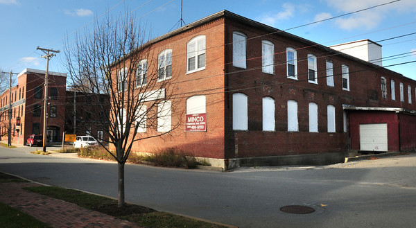 Amesbury: Chatham Furniture Reproductions was housed in this factory building on Poplar Street on the corner of Cedar Street in Amesbury. The building at left is home to various artist studios and other offices. Bryan Eaton/Staff Photo
