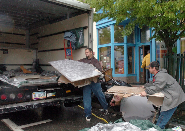 Amesbury: <br /> Mike Brown, left, and Jeremy Carlisle from Need a Handyman remove debris from water-damaged Powow River Grille.<br /> Photo by Bryan Eaton/Newburyport Daily News. Tuesday, May 16, 2006