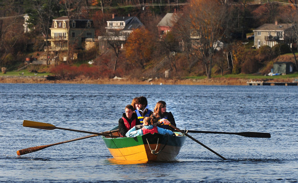 Amesbury: One of three teams of Amesbury High advanced math class leaves Lowell's Boat Shop on a field trip, part of a developing program funded by a $10,000 grant from AEFI. The students rowed the dories and used sextants to measure angles between objects along the river in order to calculate the height and distance of each landmark from one another, creating a more accurate scale for a map they have created during previous visits to the boat shop. Bryan Eaton/Staff Photo