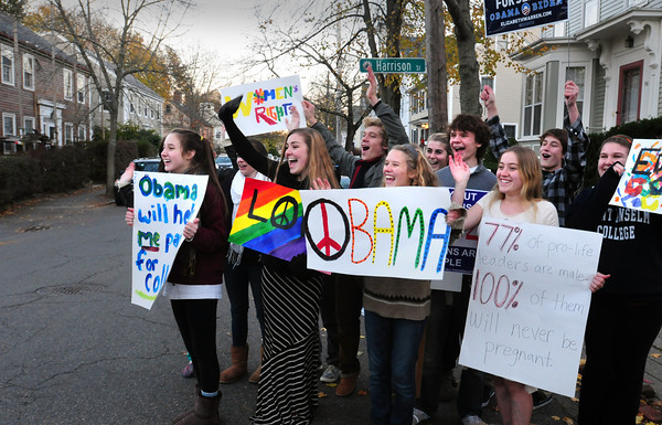 "Newburyport: Cast members of the musical ""Hair"" at Newburyport High School support President Obama and wave to passersby next to the voting station at the People's United Methodist Church in Newburyport yesterday afternoon. Bryan Eaton/Staff Photo"