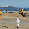 Seabrook: Water and mud gush onto Seabrook Beach in pipes taking the material being dredged from the bottom of Seabrook Harbor to replenish the dunes on Tuesday morning. Bryan Eaton/Staff Photo