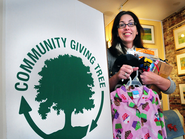 Newburyport: Valerie Stainton of Valerie's Gallery is collecting hats, mittens, pajamas and more for the Community Giving Tree. Bryan Eaton/Staff Photo