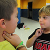 Newburyport: Cody Savage, left, and Zach Rosa, both 7, check thier pulses after four minutes of non-stop jumping jacks and jogging then they checked again after they had rested. The two were in Cathy Hill's physical education class at the Bresnahan School learning about cardio respitory stamina. Bryan Eaton/Staff Photo