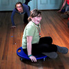 Newburyport: Julia Knight gets a push from Ava Grady, both 11, on a round scooter at the Kelley School Youth Center. Bryan Eaton/Staff Photo