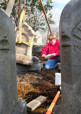 Newburyport: Ghlee Woodworth mixes epoxy to the base of this headstone, of Perley Plummer and his wife Sarah, to restore in Oak Hill Cemetery. A couple hundred stones have been vandalized or been felled by age. Bryan Eaton/Staff Photo