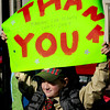Newburyport: Merrimac webelo Jesse Judson, 9, holds a sign thanking veteran's at Newburyport's Veteran's Day ceremonies. Bryan Eaton/Staff Photo