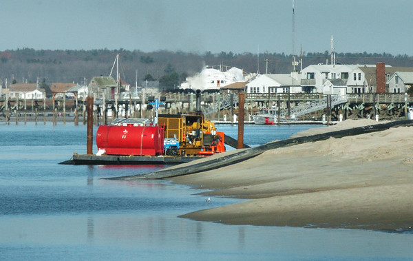 Seabrook: A huge pump on a barge sucks mud from the Hampton River close to Seabrook Harbor in huge pipes carrying it around to the beach to be deposited. Bryan Eaton/Staff Photo