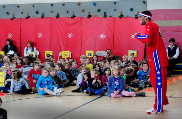 Newburyport: Harlem Globetrotters' Cheese Chisholm jokes with students at the Bresnahan School on Friday afternoon. He was at the Newburyport to present the team's anti-bullying campaign. Bryan Eaton/Staff Photo
