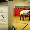 Newburyport: Newburyport assistant City Clerk Tricia Barker, right, looks over the setting up of voting booths at the Bresnahan School yesterday afternoon. Voting throughout the area is expected to be very busy today. Bryan Eaton/Staff Photo
