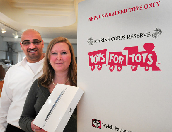 Newburyport: Matt and Karyn Khatib of MK Winston's are giving chances to a raffle an IPad for people who drop off items for Toys For Tots. Bryan Eaton/Staff Photo