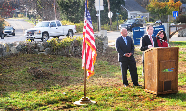 Newburyport: Massachusetts Secretary of Transportation Richard Davey speaks to a small gathering flanked by Newburyport Mayor Donna Holaday, right, and state Rep. Mike Costello at a ceremony marking the $1 million dollar Spofford Roundabout Project on Thursday morning. The project is part of the Massachusetts DOT's Small Bottleneck Grant Program. Bryan Eaton/Staff Photo