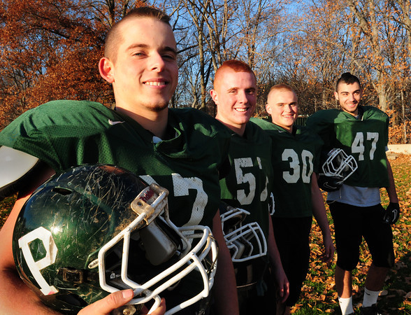 West Newbury: The Pentucket High football defensive line, from left, Connor McGuirk, Chad Legault, Mike McCarron and Franco Pizzarella. Bryan Eaton/Staff Photo