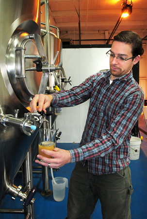 Newburyport: Head brewer and founder of Riverwalk Brewing Co. Steve Sanderson takes a sample of his India pale ale. The company with roots in Amesbury has moved to a larger location on Graf Road in Newburyport. Bryan Eaton/Staff Photo