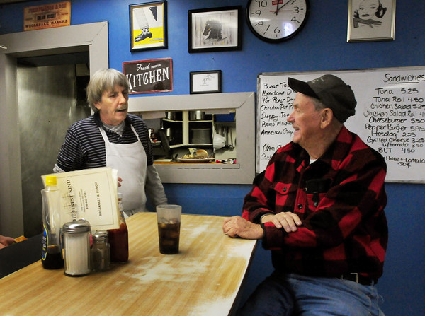 Newburyport: Joe Donahue, right, is now a customer at the Finest Kind talking with present owner and cook David Rice. Bryan Eaton/Staff Photo