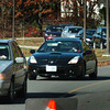 Amesbury: A line of cars extended down the driveway at Amesbury High School during noon yesterday as throngs headed to cast their votes. Bryan Eaton/Staff Photo