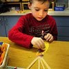 Rowley: Jack Lyman, 5, works to create an ear of corn as decoration for his Thanksgiving Feast on Tuesday morning. He was in Aleta Budd's kindergarten class at the Pine Grove School in Rowley. Bryan Eaton/Staff Photo