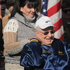 Amesbury: Donna Boulay hold hand with her father Robert Wilbur, a World War 2 veteran as a letter she wrote to teh Daily News is read at the city's annual Veteran's Day service at the Doughboy statue in Amesbury for . Jim Vaiknoras/staff photo