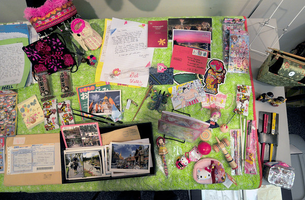Merrimac: A table of items from Japan a recieption of items and letters from around the world sent to Emma Journeay who died of cancer this past August at the age of nine. Jim Vaiknoras/staff photo