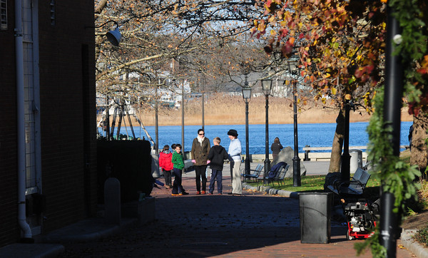 Newburyport: People walk in Market Landing Park in Newburyport Thursday enjoying the bright cold sunshine. Jim Vaiknoras/staff photo