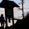 Newbury: A woman leaves Plum Island Beach thursday as the sun sets. Jim Vaiknoras/staff photo
