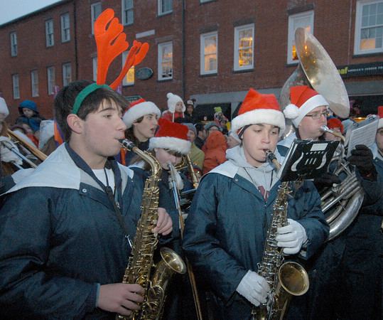 Newburyport: Members of the Triton band perform holiday songs and Christmas Carols at the annual parade and tree lighting in Market Square in Newburyport Sunday. Jim Vaiknoras/staff photo