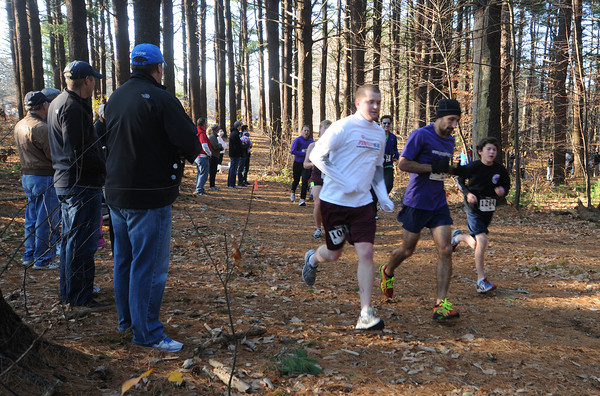Newburyport: Runners head through the woods at Maudslay Thursday morning for the 24th annual Turkey Trot. JIm Vaiknoras/staff photo