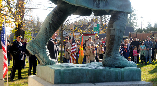 Amesbury: People gather around the Doughboy statue in Amesbury for the city's annual Veteran's Day service. Jim Vaiknoras/staff photo