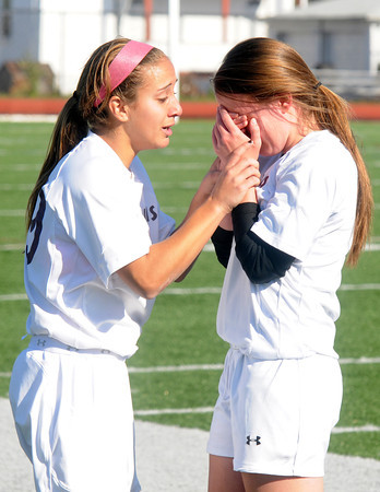 Lynn: Newburyport's Jaycie Triandafilou consoles teammate Jacqueline Krusemark after the  Clippers1-0 overtime loss to Belmont Saturday at Manning Field in Lynn. Jim Vaiknoras/staff photo