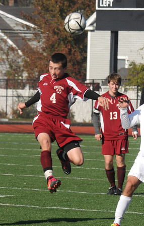Lynn: Newburyport's Connor Glynn goes up for a header during the Clippers3-0 loss at Manning Field in Lynn Saturday. Jim Vaiknoras/staff photo
