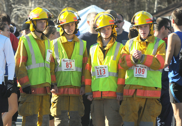 Salisbury:Tom Mulligan, Casey Reale, Sean Manion, and Owen Ricker of the Georgetown Fire Explorers honor the late Timothy J. Oliveira at the 2nd annual Timmy Trot Saturday. Jim Vaiknoras/staff photo