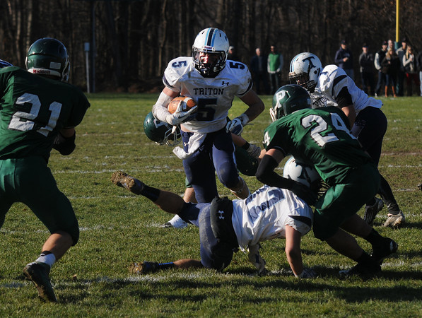 West Newbury:Triton's Justin Spillane looks for running room during the Viking's 41-12 loss to Pentucket. JIm Vaiknoras/staff photo