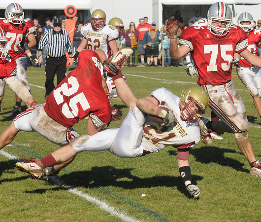Amesbury: Amesbury's Ben Cullen upends Newburyport'sTyler Cusack during Amesbury's 13-10 victory against Newburyport Thursday. JIm Vaiknoras/staff photo
