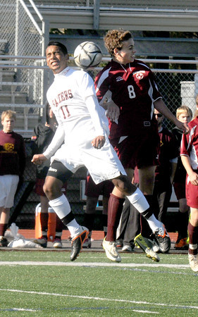 Lynn: Newburyport's Allan Eagan goes up for a header with Watertown's Juan Nieto-Lopez during the Clippers3-0 loss at Manning Field in Lynn Saturday. Jim Vaiknoras/staff photo