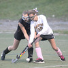 Amesbury: Newburyport's Eliza Filipancic fights for the ball against a Wayland player during their game at Amesbury Sports Park Thursday night. JIm Vaiknoras/staff photo