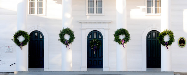Amesbury: Wreaths welcoming the Christmas season hang on the pillars at the  Main Street Church in Amesbury. Jim Vaiknoras/staff photo