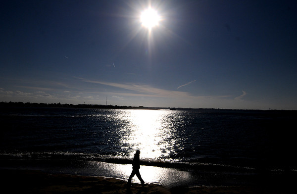 Salisbury: Danny Cahill walks along the Merrimack river in Salisbury sunday afternoon. JIm Vaiknoras/staff photo