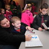 Merrimac: Donna Haynes and her sons Jacob, 3, and Zachary. 9. make cards at the Merrimack Library Thursday night. They were attending a recieption to show some of the many items and letters from around the world sent to Emma Journeay who died of cancer this past August at the age of nine. Jim Vaiknoras/staff photo