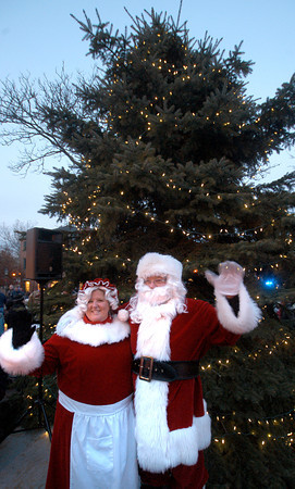 Newburyport: Santa and Mrs Claus pose infrom of the newly lit Christmas Tree in Market Square Sunday. Jim Vaiknoras/staff photo