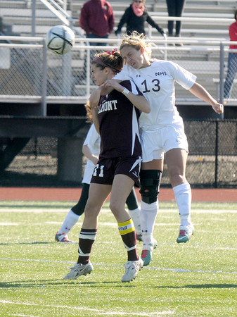 Lynn: Newburyport's Abigale Muise goes up for a header with a Belmont player at Manning Field in Lynn. The  Clippers lost 1-0 overtime Saturday. Jim Vaiknoras/staff photo