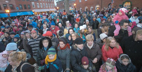 Newburyport: Crowds fill Market Square in Newburypor for the annual parade and tree lighting Sunday. Jim Vaiknoras/staff photo