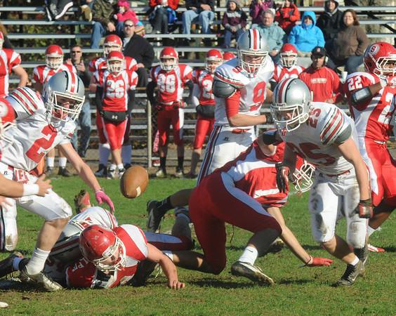 Saugus: All Indian eyes are on a Saugus fumble in the first half of Amesbury's game against the Sachems in Saugus Saturday. Jim Vaiknoras/staff photo