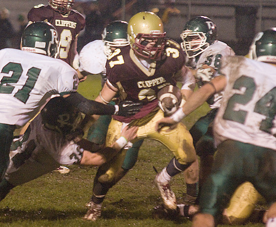 Newburyport: Newburyport's Samual Francis looks for yardage aginast Pentucket Friday night at World War Memorial Stadium in Newburyport> JIm Vaiknoras/staff photo