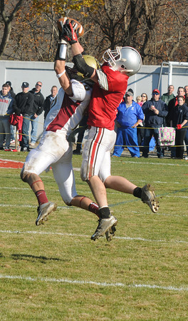 Amesbury:Newburyport's Drew Bourdeau picks off a pass intended for Amesbury's  Tommy Connors during their game at amesbury Thursday. JIm Vaiknoras/staff photo