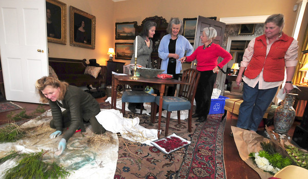 Newburyport: Elizabeth Petty , Rosamond Smith, Judy Wilkinson,Kim Mack and Wanda Blanchard, all from the Newburyport Garden Club prepare to decorate the Cushing House in Newburyport Friday. Jim Vaiknoras/staff photo
