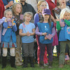 Amesbury: Amesbury Daisey troop  hold flags at the city's annual Veteran's Day service at the Doughboy statue in Amesbury for . Jim Vaiknoras/staff photo