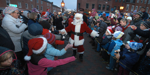 Newburyport: Santa makes his way through the crowd to for the annual parade and tree lighting in Newburyport Sunday. Jim Vaiknoras/staff photo
